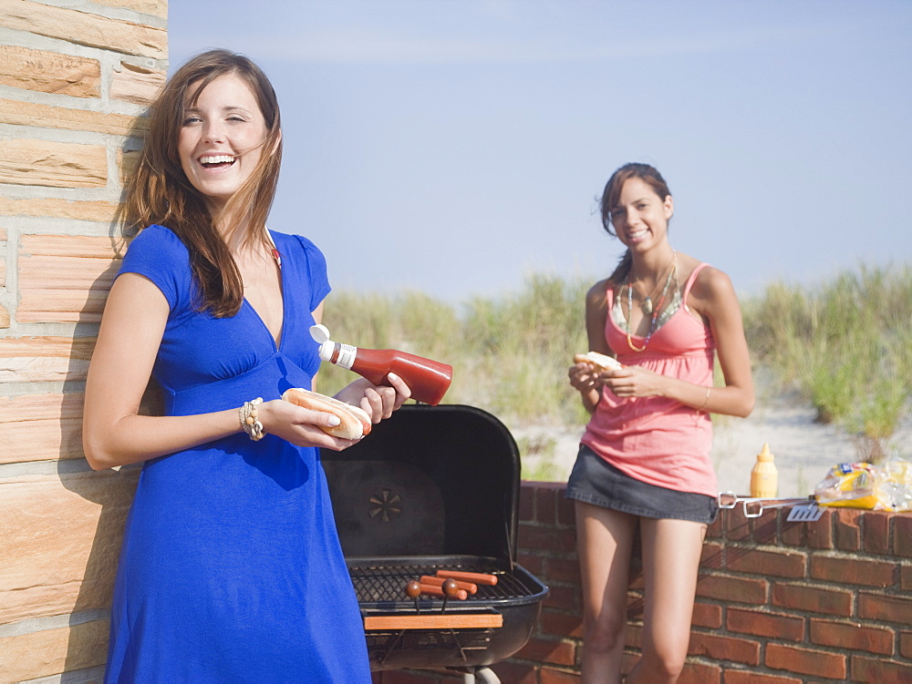 Young women at barbecue