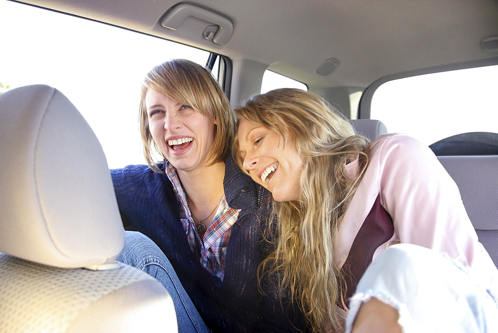 Two women in backseat of car