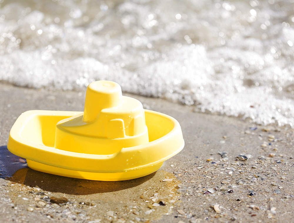 Toy boat on beach
