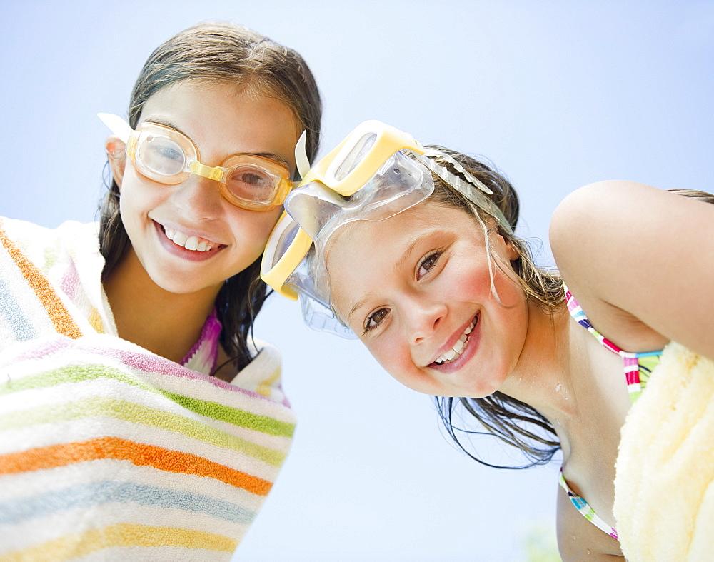 USA, New York, Two girls (10-11, 10-11) wearing swimming goggles