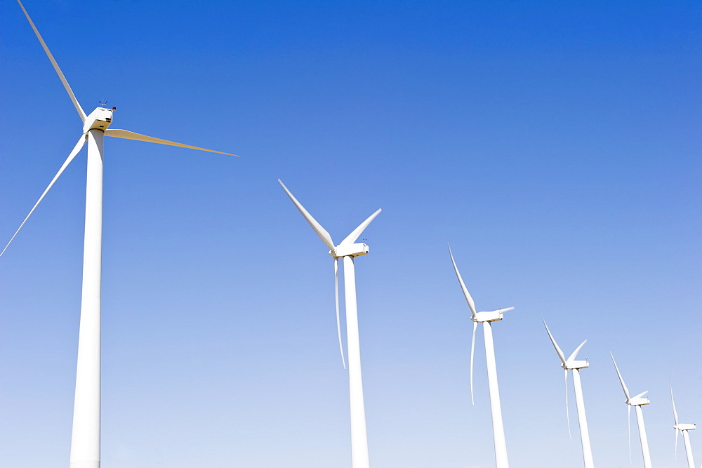 USA, California, Palm Springs, Coachella Valley, San Gorgonio Pass, Wind turbines against blue sky