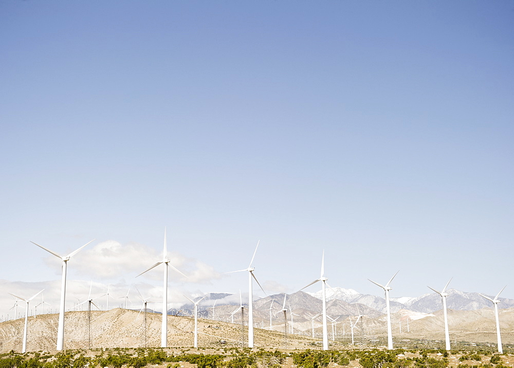 USA, California, Palm Springs, Coachella Valley, San Gorgonio Pass, Wind turbines with mountains in background