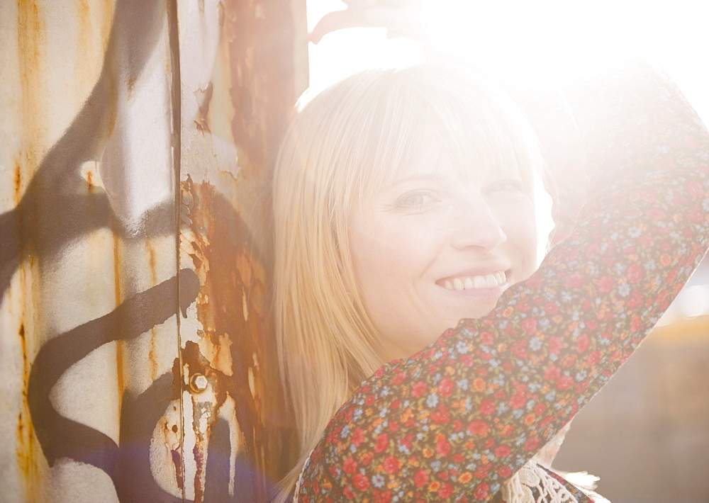 USA, Brooklyn, Williamsburg, Portrait of blonde woman in backlit