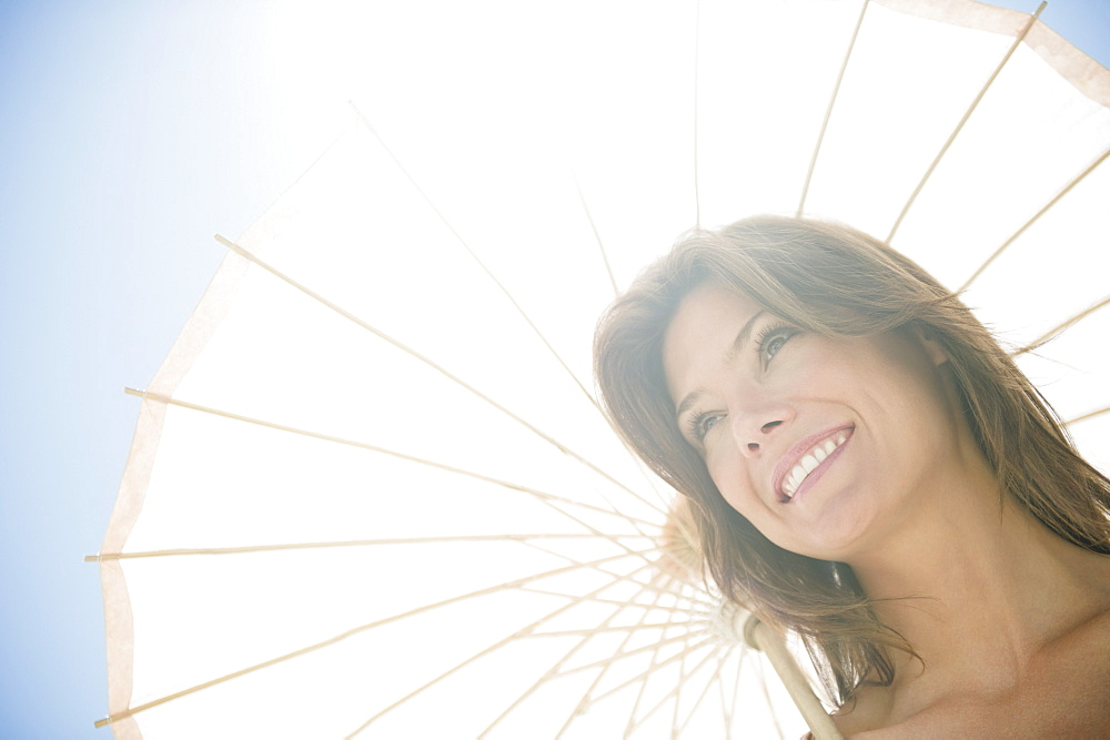 Woman in sunlight with parasol