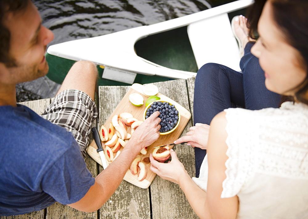 Roaring Brook Lake, Couple eating fruits on pier - 1178-17236