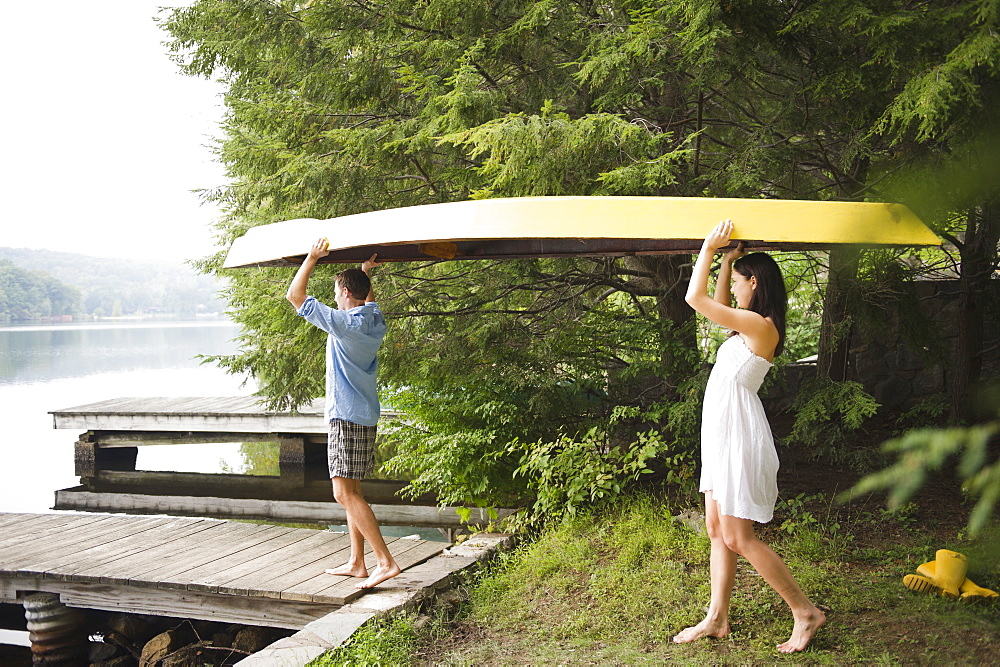 Roaring Brook Lake, Couple carrying boat by lake