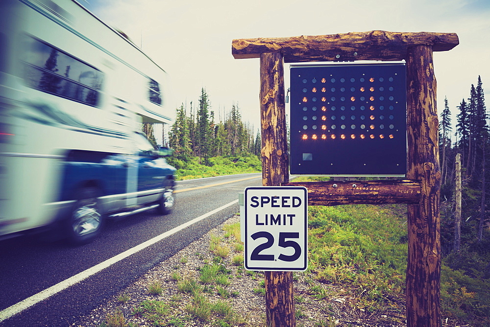 Motor home passing 25 mph speed limit sign, RCedar Breaks National Monument, Utah