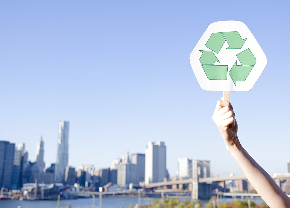 USA, New York State, New York City, Manhattan, Hand holding recycling symbol