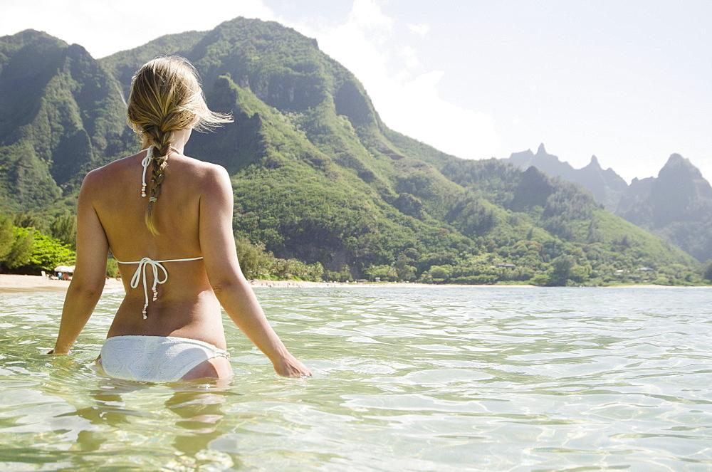 Tunnels Beach, Woman walking in sea, USA, Hawaii, Kauai, Tunnels Beach