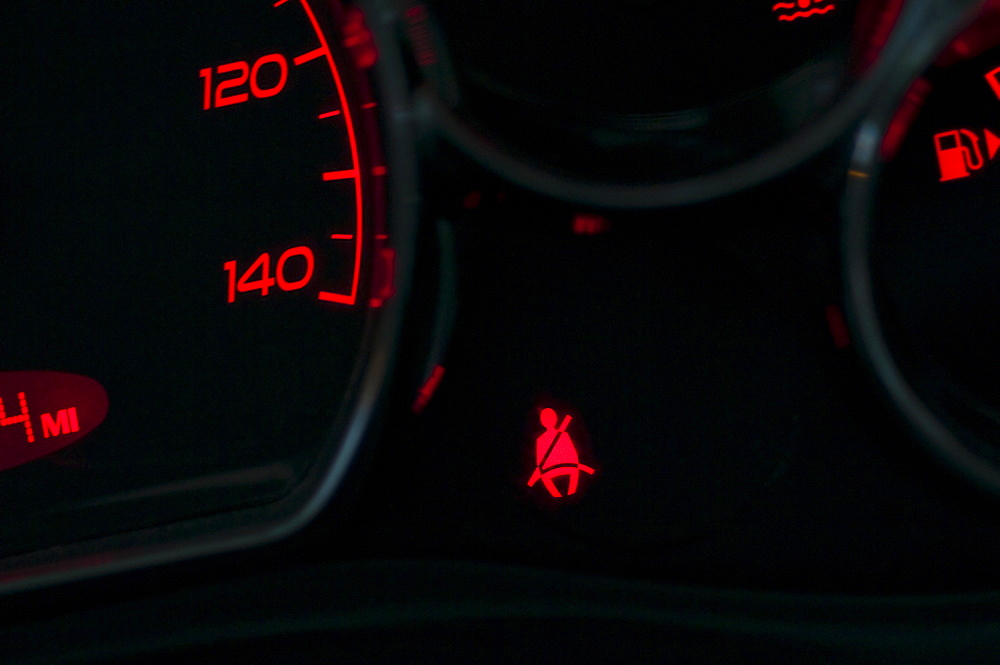 The seat belt warning on the dashboard of a car
