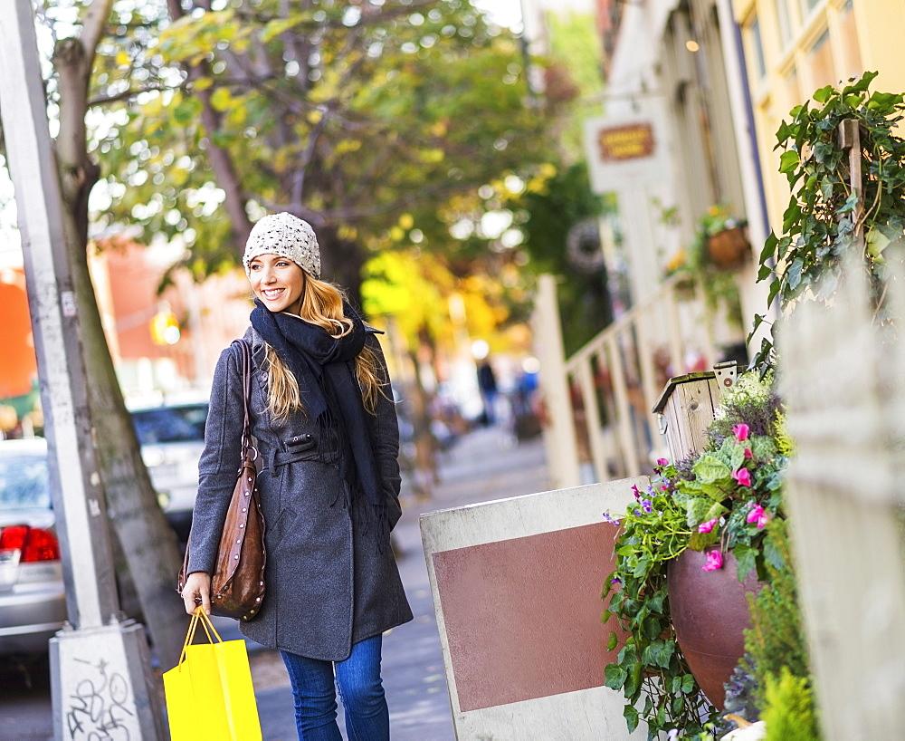 Portrait of blond woman walking on sidewalk, USA, New York City, Brooklyn, Williamsburg