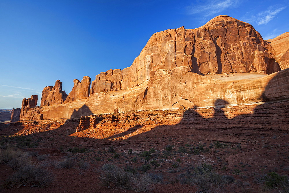 Sunset over majestic rock formation, USA, Utah, Arches National Park, Moab