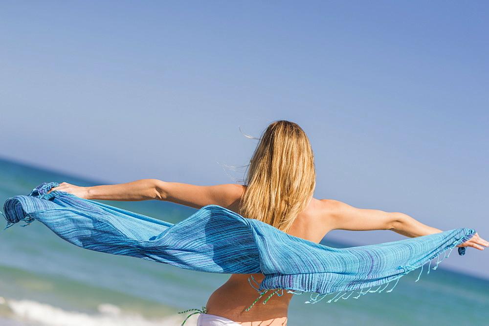 Young woman on beach, Jupiter, Florida, USA
