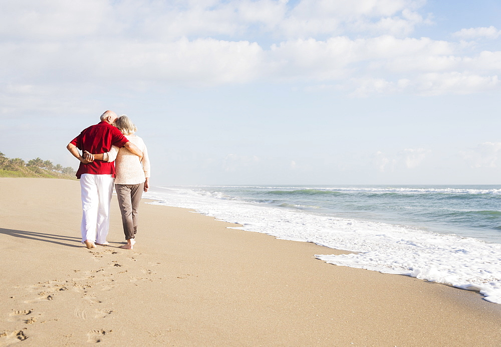 Senior couple walking on beach, Jupiter, Florida