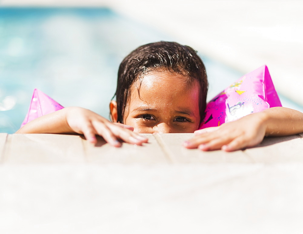 Portrait of girl ( 4-5) with water wings