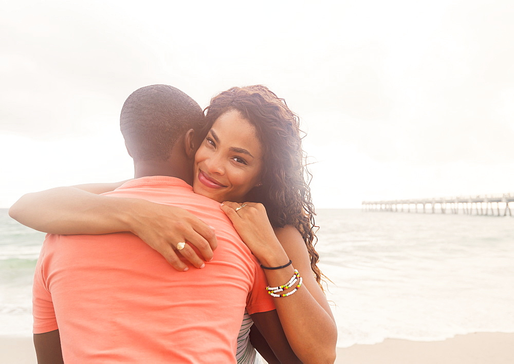 Young couple embracing on beach, Jupiter, Florida