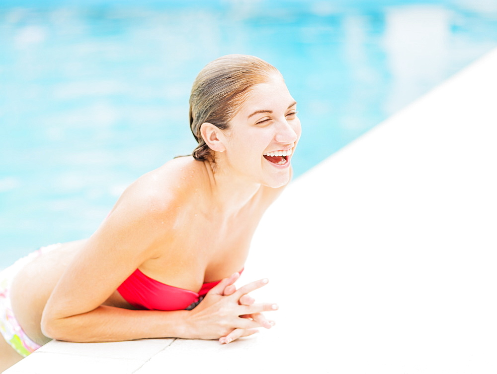Portrait of woman on edge of swimming pool