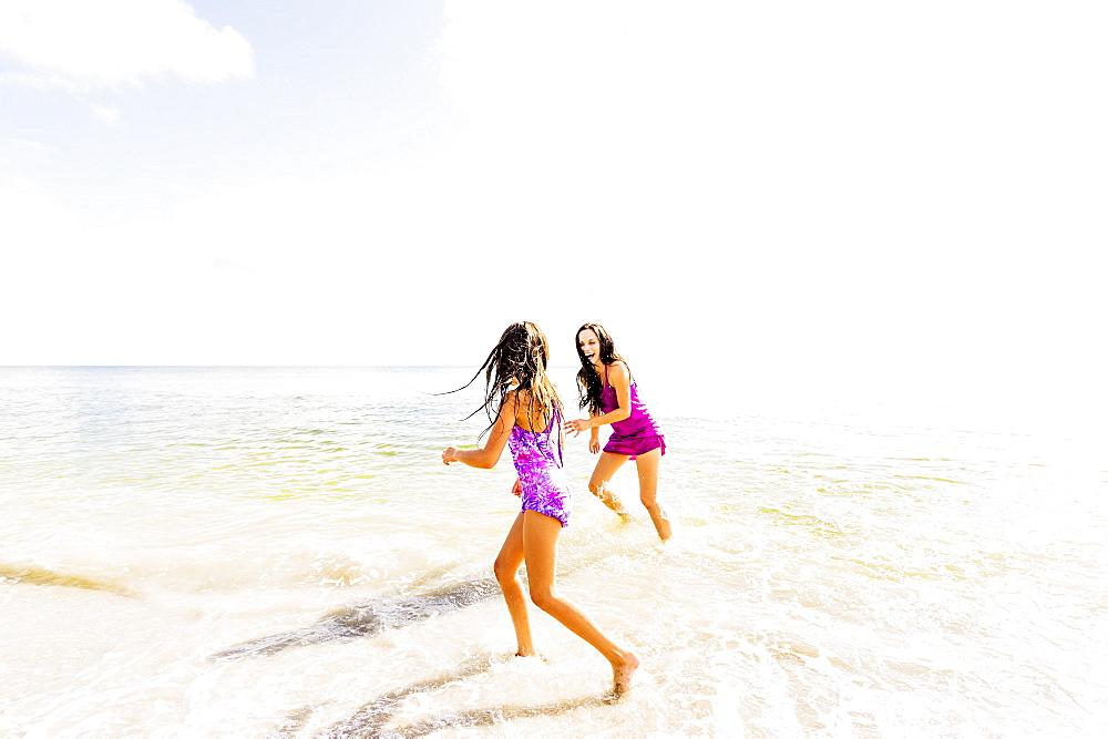 Girl (6-7) and her mom enjoying themselves on beach, Jupiter, Florida