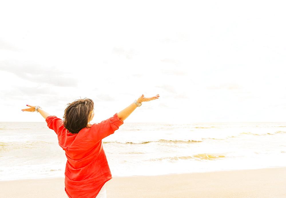 Rear view of woman looking at ocean, Jupiter, Florida