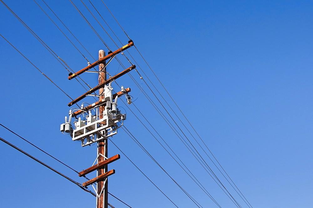 Power line against blue sky