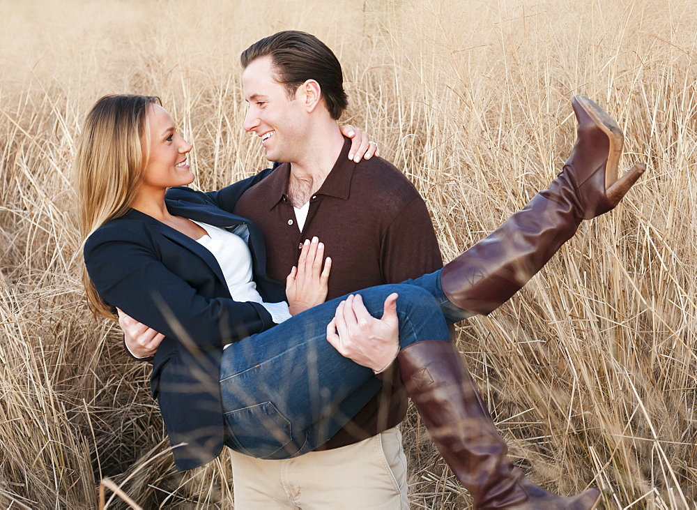 Happy young couple on wheat field