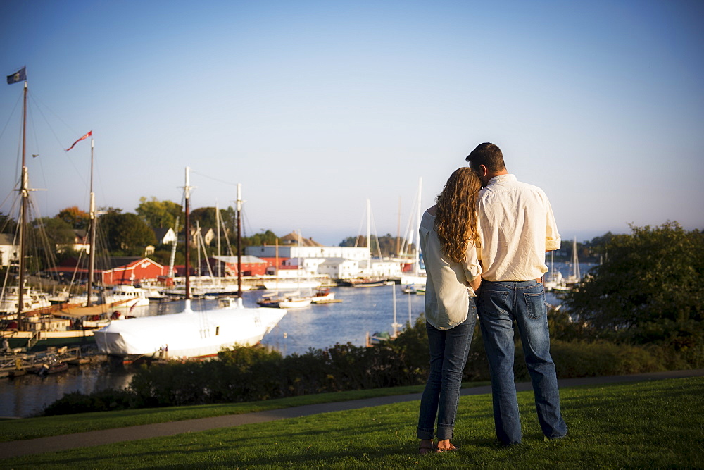 Back view of couple looking at harbor, Camden, Maine