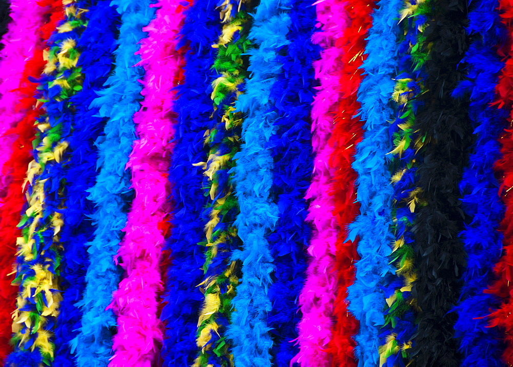 Feather boas hanging in a row