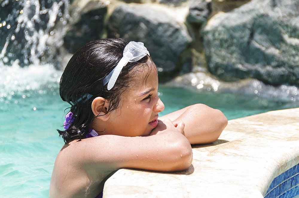 View of girl (8-9 years) wearing swimming goggle, Humacao, Puerto Rico