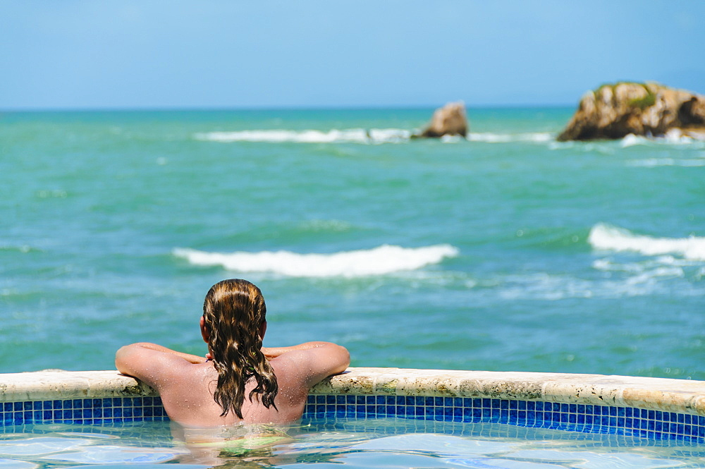 Rear view of mature woman looking at sea, Humacao, Puerto Rico