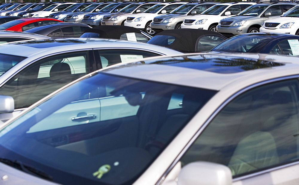 Rows of new cars on lot