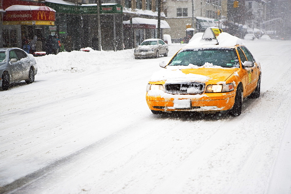 Taxi cab in snow, New York City