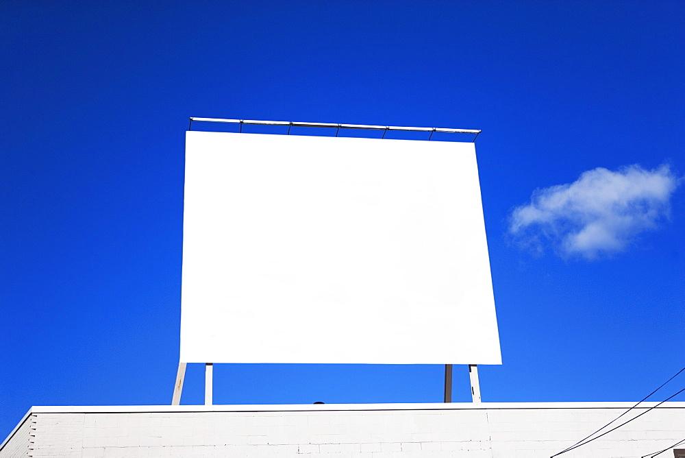 Blank billboard under blue sky