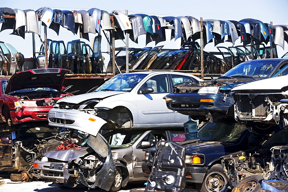Cars and car parts in junkyard