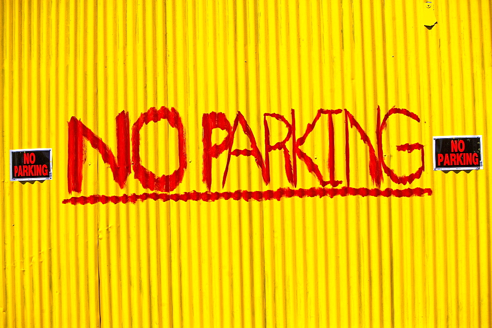 No Parking painted on wall