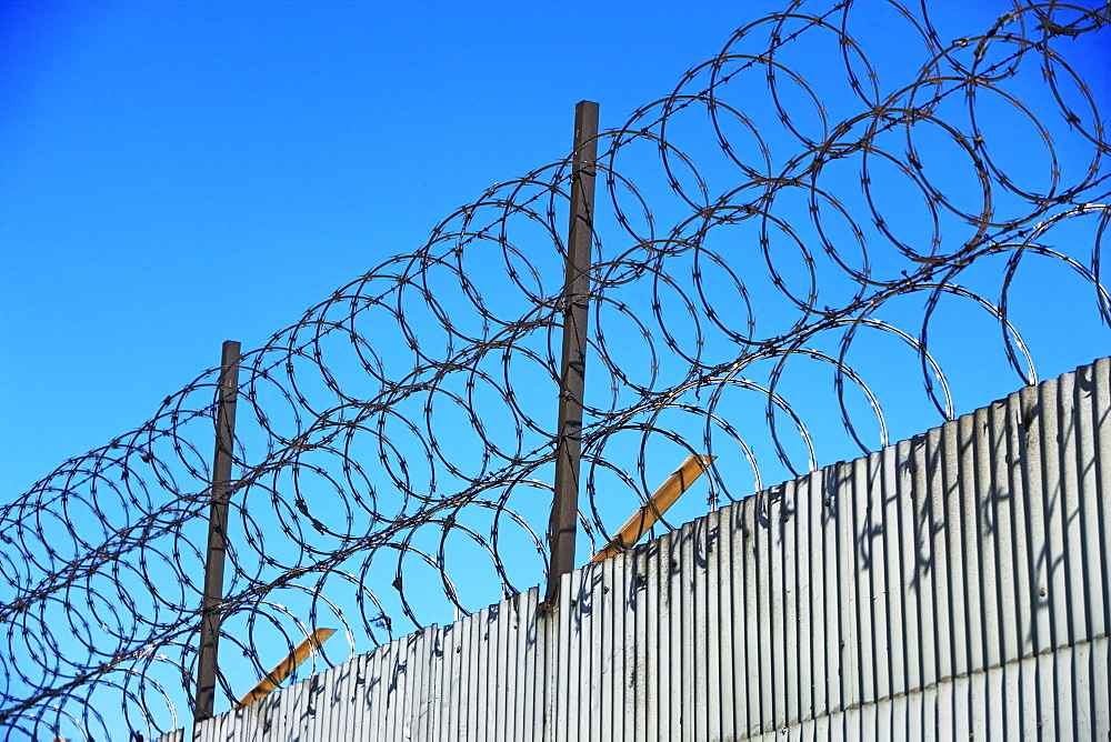 Low angle view of barbed wire fence