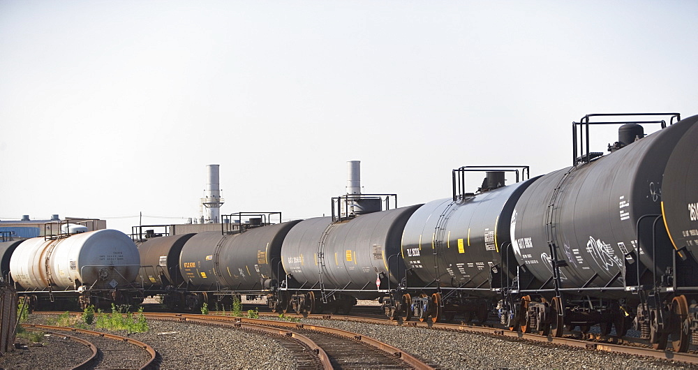 Row of oil tankers in train track