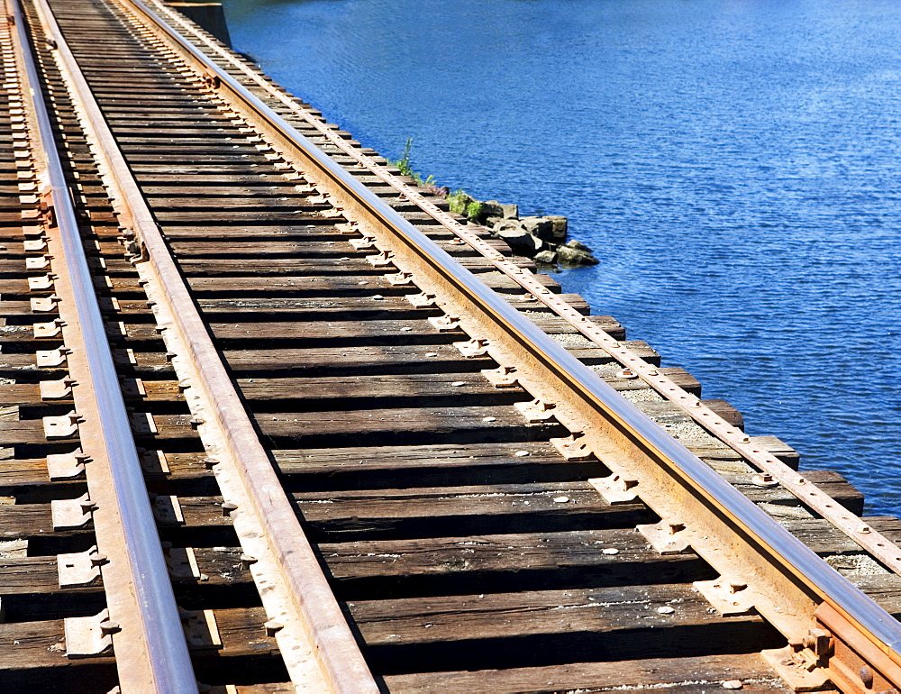 Train tracks at water's edge