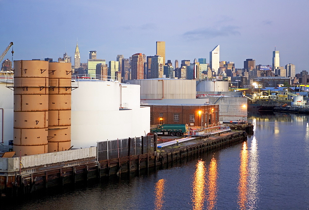 Oil storage tanks with New York City in background