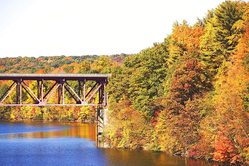 Bridge among autumn foliage, New York