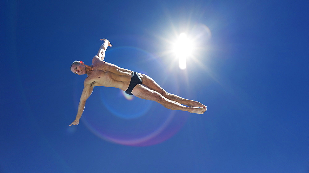 Athletic swimmer jumping