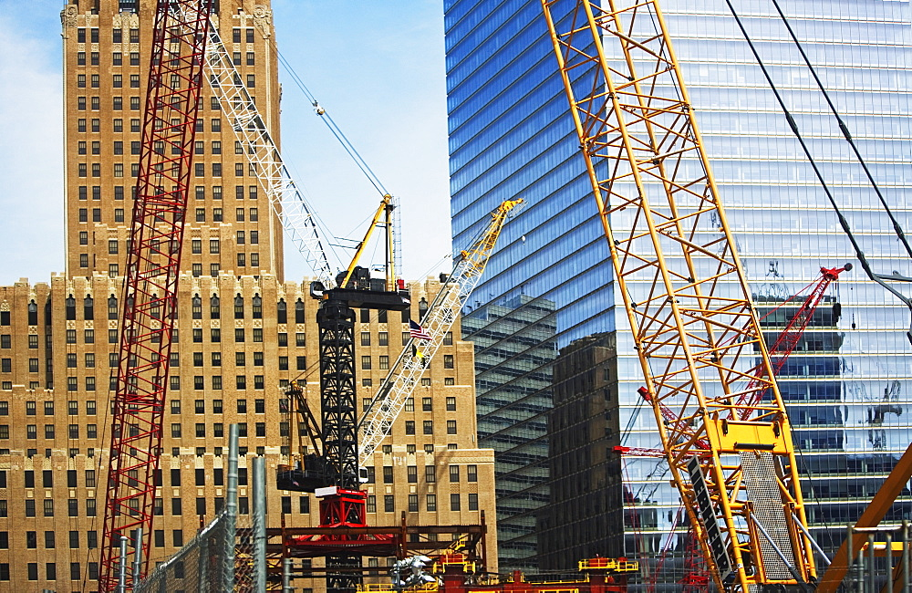 Cranes in front of buildings