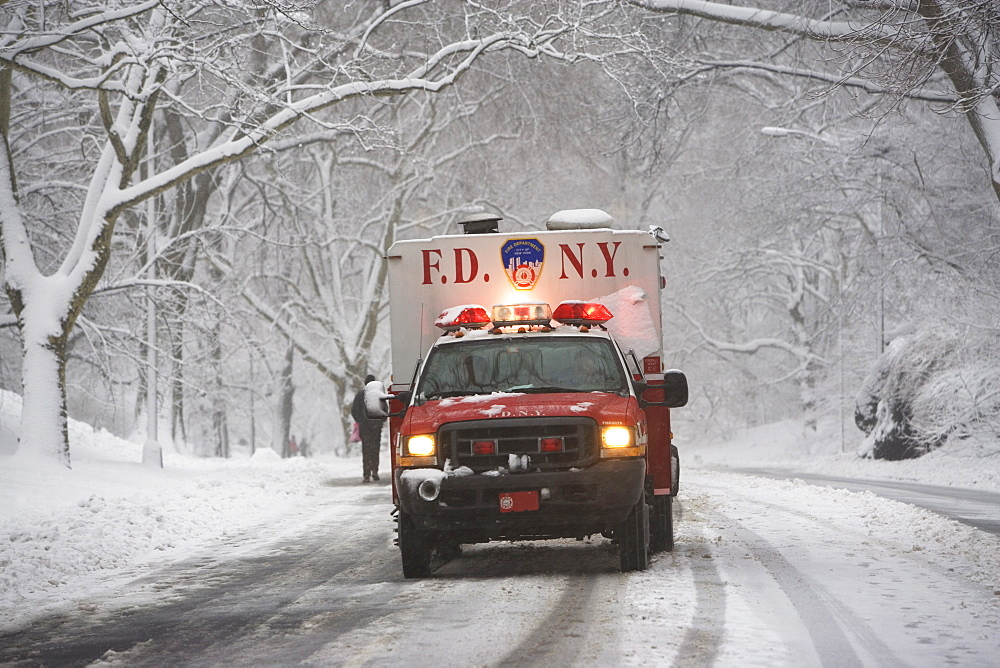 New York City fire department vehicle driving on snowy road - 1178-19968