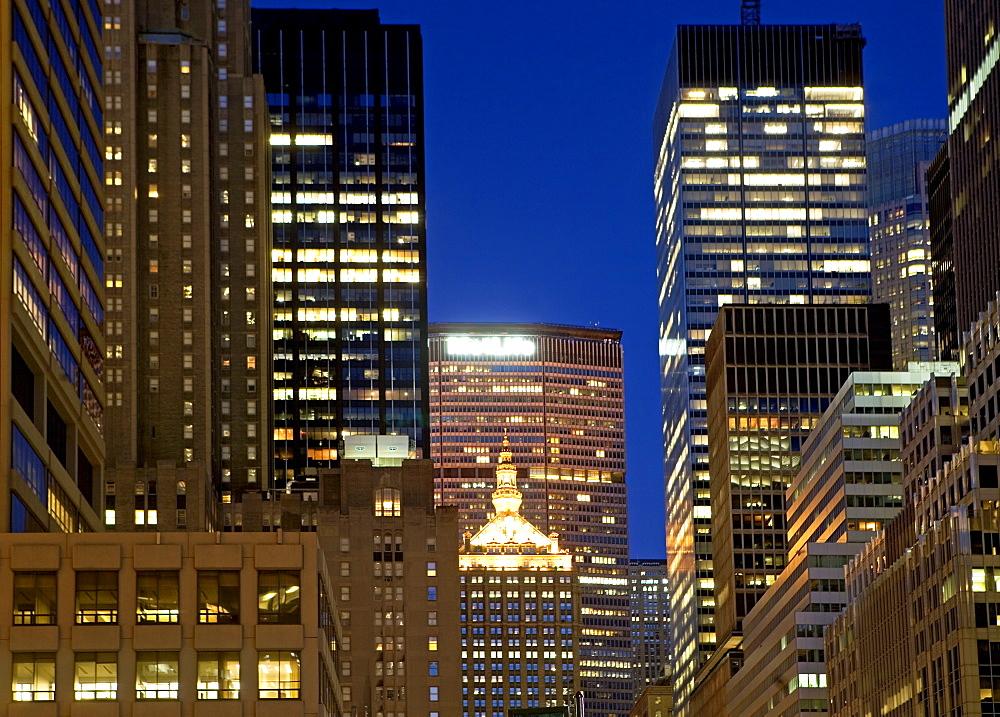 USA, New York State, New York City, Office buildings illuminated at night