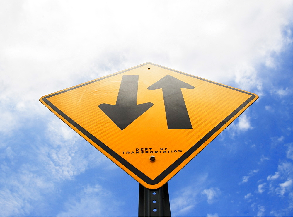 Road sign against sky, low angle view