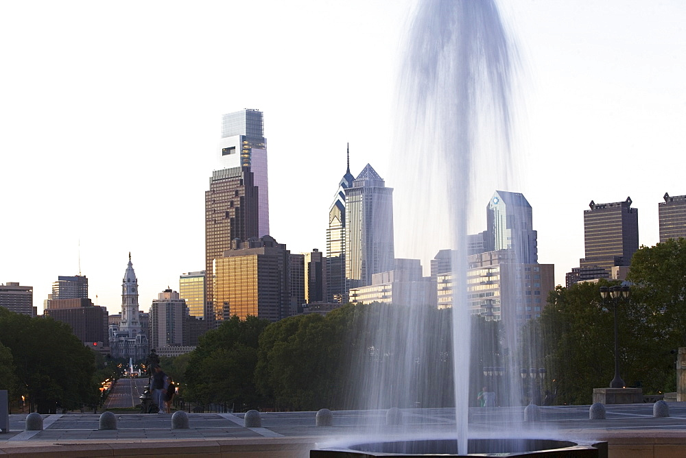 USA, Pennsylvania, Philadelphia, Fountain in Park, Skyline in background