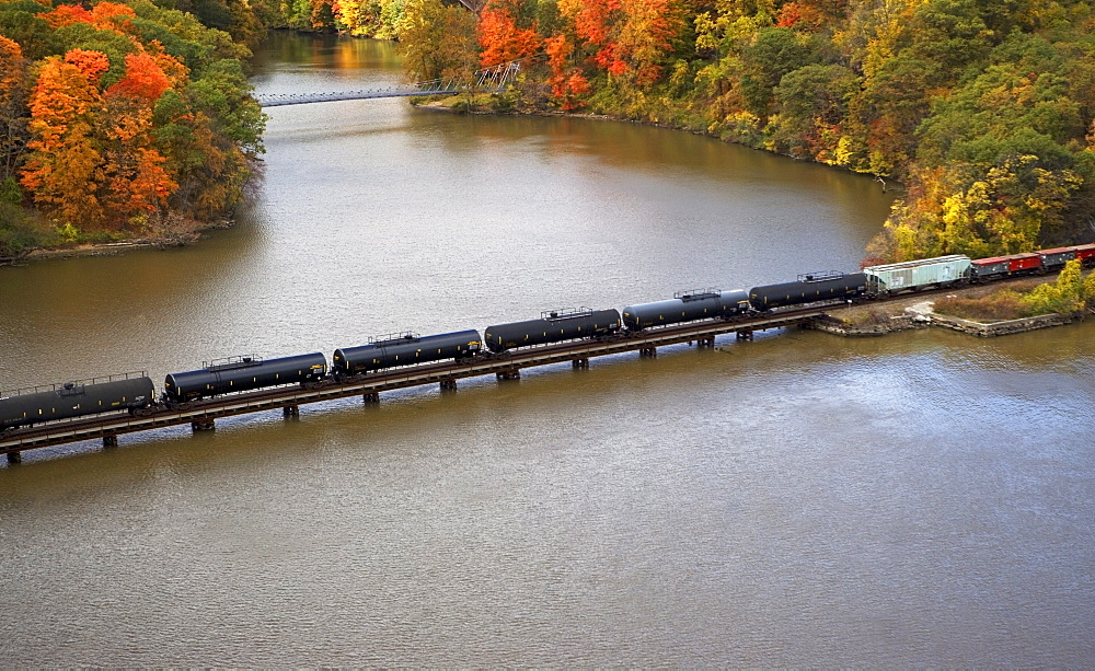 USA, New York, Bear Mountain, aerial view of train crossing lake