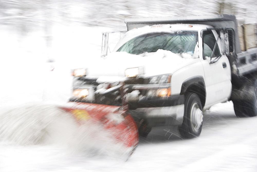 USA, New York City, snowplowing truck