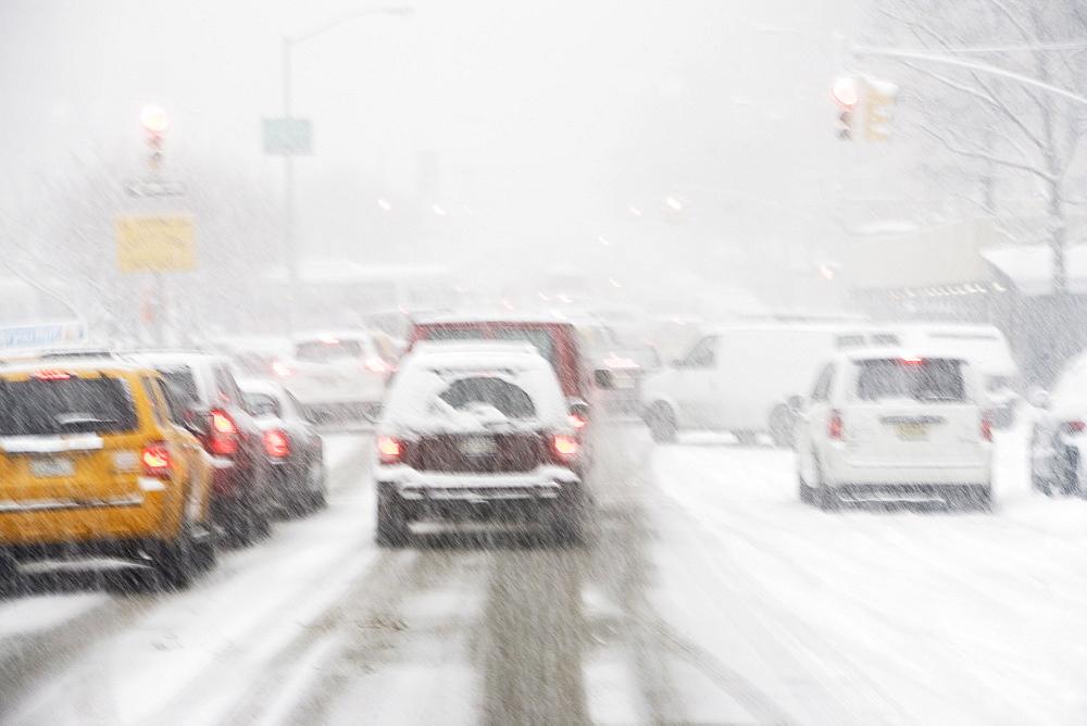 USA, New York City, city traffic in snowstorm