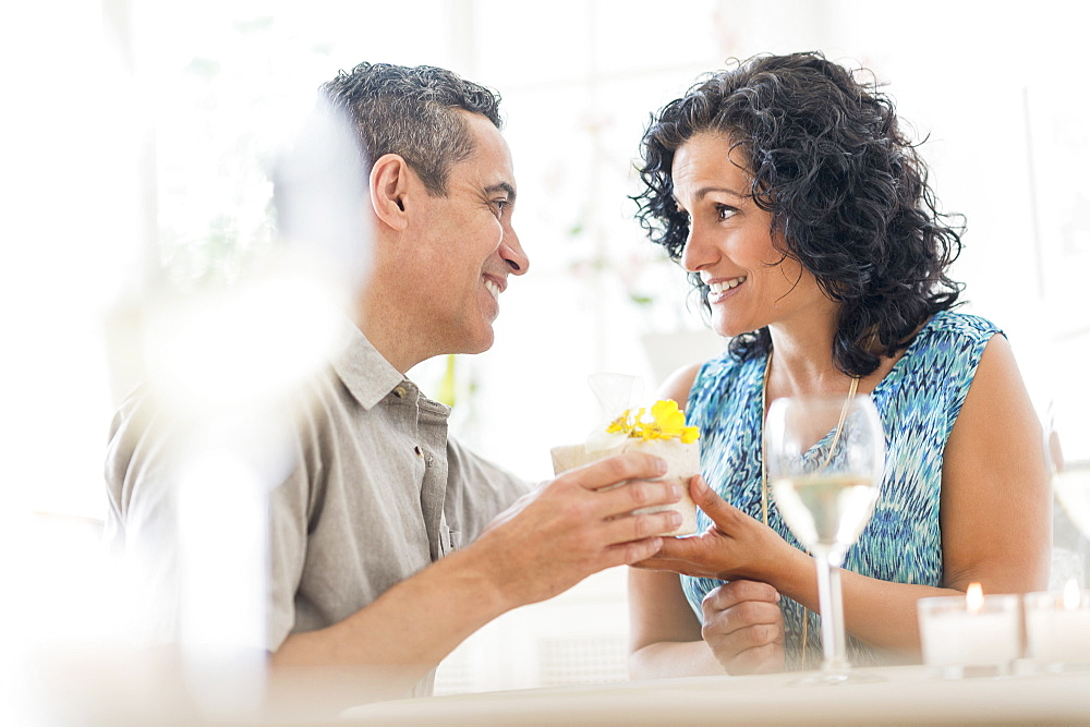 Couple celebrating anniversary in restaurant