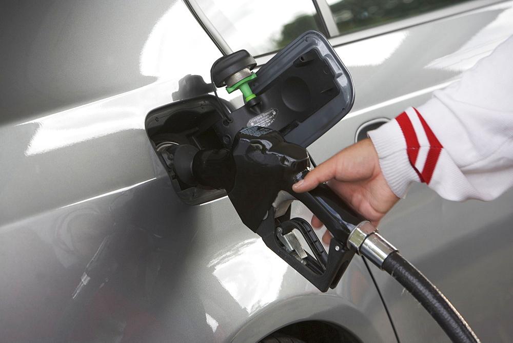 Human hand holding refueling pump